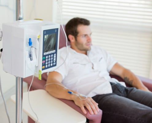 IV Drip Attached To Patient's Hand During Chemotherapy